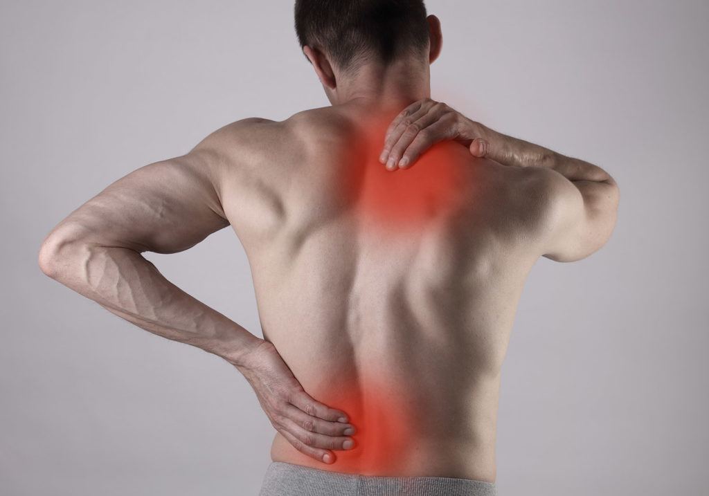 Photo depicting back pain, one of the conditions cured by Regis Chiropractic